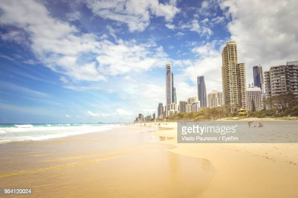 panoramic view of beach and buildings against sky - gold coast queensland stock pictures, royalty-free photos & images