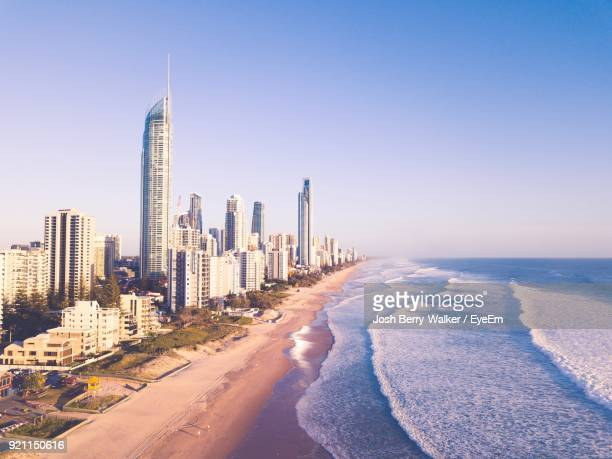 panoramic view of beach with city in background - gold coast queensland stock pictures, royalty-free photos & images
