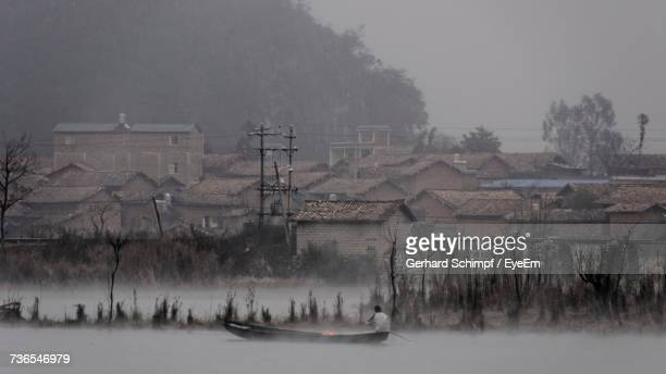 panoramic view of boats in winter against sky during foggy weather - gerhard schimpf stock pictures, royalty-free photos & images