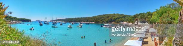 panoramic view of boats on sea against blue sky - hvar stock photos and pictures
