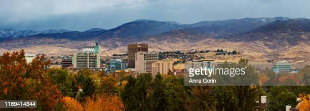 panoramic view of boise idaho downtown skyline in 2019, autumn afternoon with low clouds lingering over snow-covered foothills - lingering stock pictures, royalty-free photos & images
