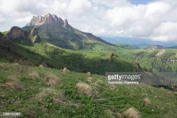 panoramic view of bolshoy tkhach, caucasus mountains - argenberg stock pictures, royalty-free photos & images