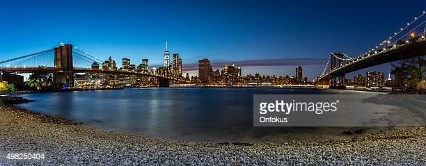 Panoramic View of Brooklyn Bridge and Manhattan at night, NYC