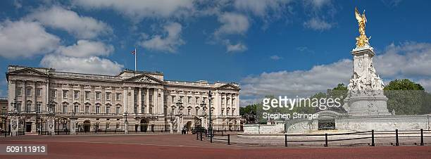 Panoramic view of Buckingham Palace devoid of the usual crowds. Blue sky with a few clouds