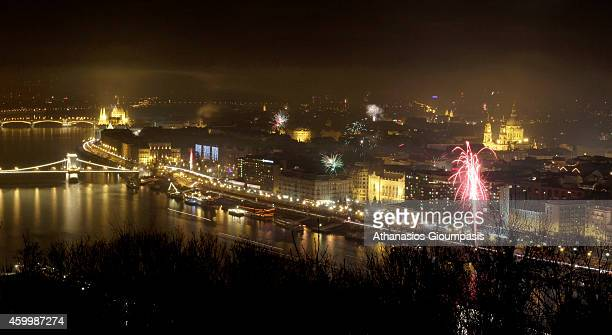 Panoramic view of Budapest with fireworks at New Years Day from the Gellert Hill on Decemper 31 2011 in Budapest Hungary