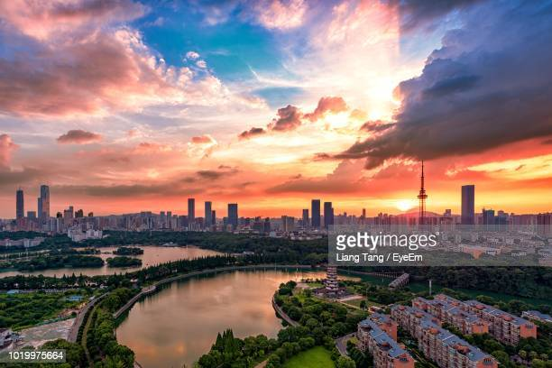 panoramic view of buildings against cloudy sky during sunset - changsha stock pictures, royalty-free photos & images