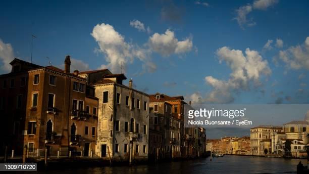 panoramic view of buildings against cloudy sky - monza stock pictures, royalty-free photos & images
