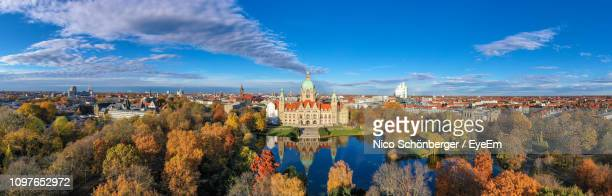 panoramic view of buildings against sky - hanover germany stock pictures, royalty-free photos & images