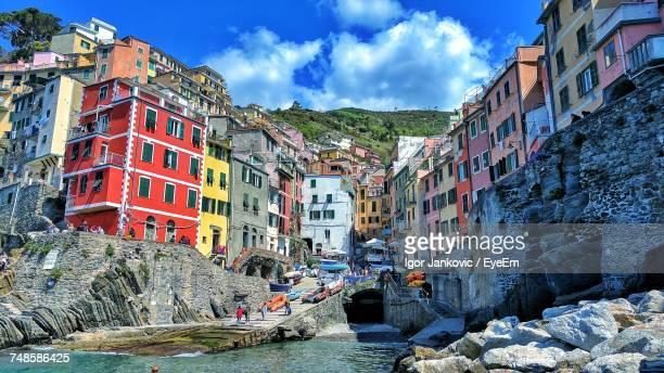 panoramic view of buildings against sky - cinque terre stock pictures, royalty-free photos & images