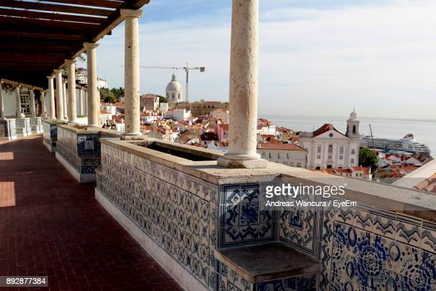 panoramic view of buildings against sky - alfama stock photos and pictures