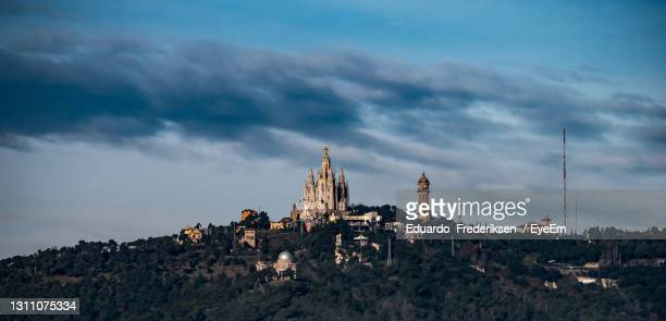 panoramic view of buildings and city against sky - tibidabo stock pictures, royalty-free photos & images