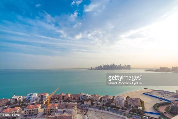 panoramic view of buildings and sea against sky - viewpoint stock pictures, royalty-free photos & images
