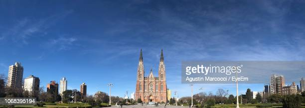 panoramic view of buildings in city against blue sky - la plata argentina stock pictures, royalty-free photos & images
