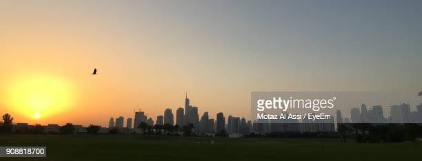 Panoramic View Of Buildings In City Against Sky During Sunset