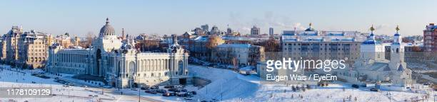 panoramic view of buildings in city during winter - kazan russia stock pictures, royalty-free photos & images