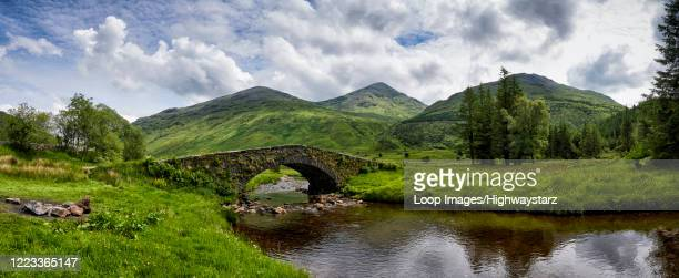 panoramic view of butter bridge over kinglas water in the loch lomond national park in scotland - lake stock pictures, royalty-free photos & images