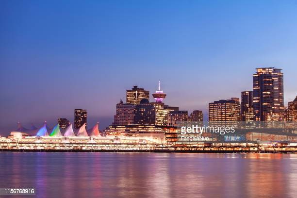 panoramic view of canada place in downtown vancouver at night - vancouver stock pictures, royalty-free photos & images