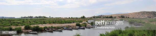 panoramic view of canal with fishing boats - emreturanphoto stock pictures, royalty-free photos & images