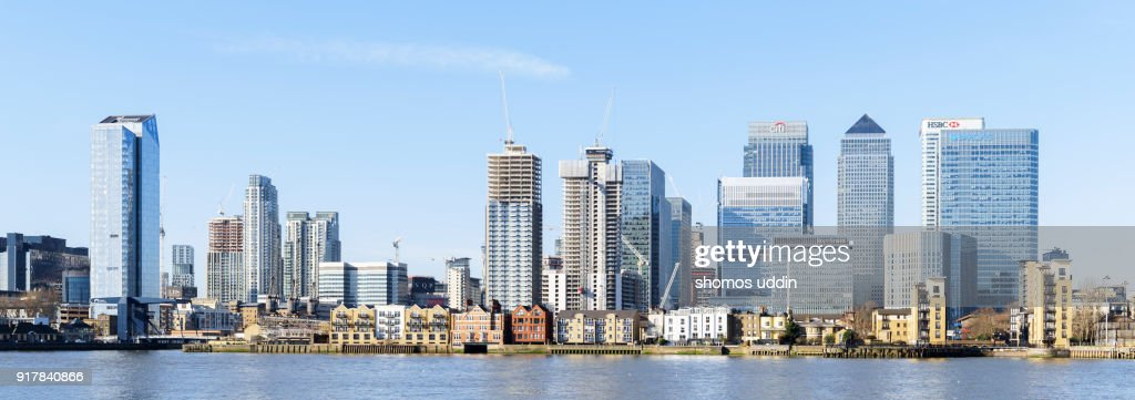 Panoramic view of Canary Wharf and the city skyline across River Thames : Stock Photo