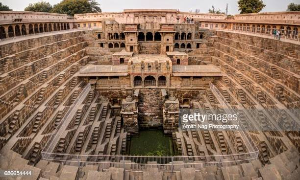 a panoramic view of chand baori stepwell - stepwell stock photos and pictures