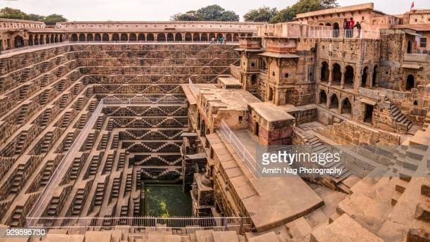 a panoramic view of chand baori stepwell - abhaneri stock photos and pictures