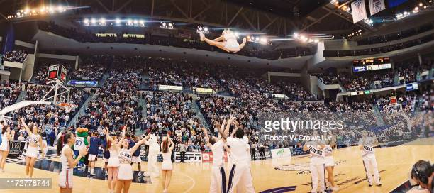 Panoramic view of cheerleaders as they perform during a sold out Big East basketball game between the University of Connecticut and the University of...