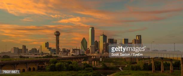 panoramic view of city against cloudy sky during sunset - dallas stock pictures, royalty-free photos & images