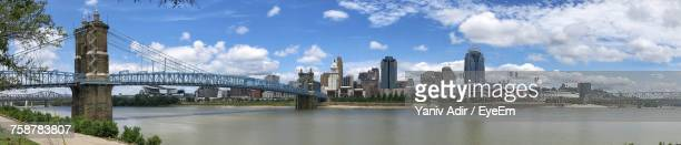 panoramic view of city against cloudy sky - cincinnati stock pictures, royalty-free photos & images