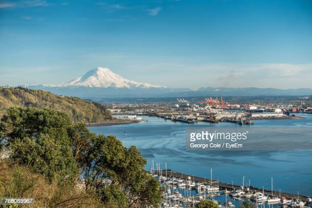 panoramic view of city against cloudy sky - tacoma stock pictures, royalty-free photos & images