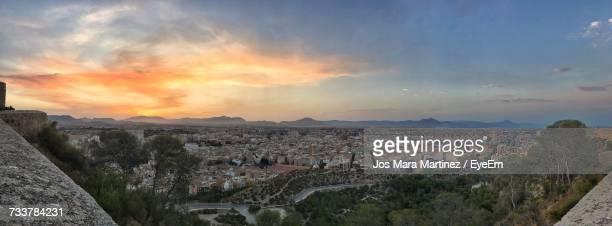 panoramic view of city against sky during sunset - mara martinez stock-fotos und bilder