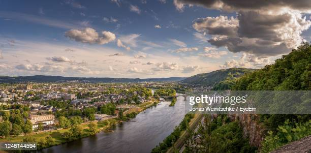 panoramic view of city against sky - moseltal stock-fotos und bilder
