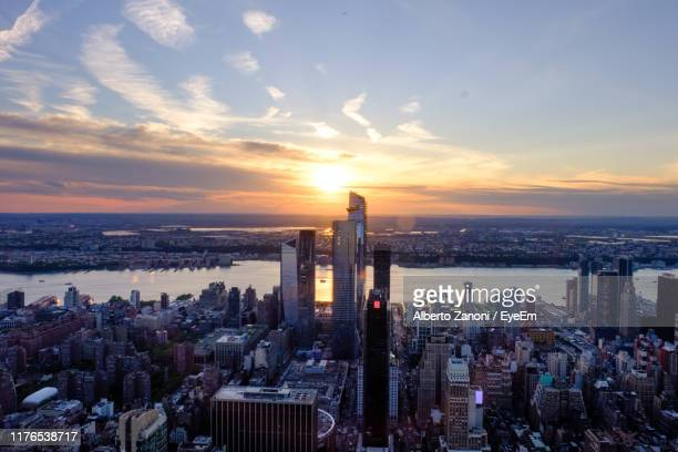 panoramic view of city buildings against sky during sunset - hudson yards stock pictures, royalty-free photos & images