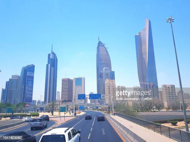 panoramic view of city buildings against sky - kuwait city stock pictures, royalty-free photos & images