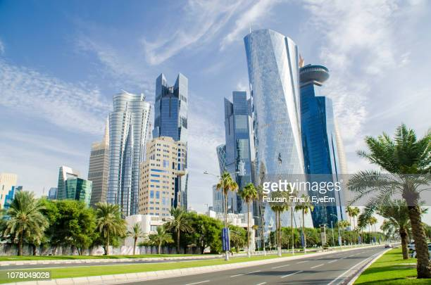 panoramic view of city buildings against sky - doha stockfoto's en -beelden