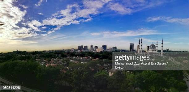 panoramic view of city buildings against sky - shah alam stock photos and pictures