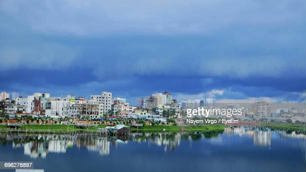 panoramic view of city by river against sky - bangladesh stock pictures, royalty-free photos & images