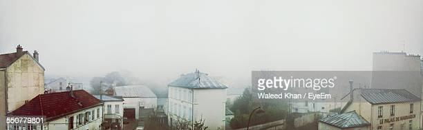 Panoramic View Of City In Foggy Weather Against Clear Sky