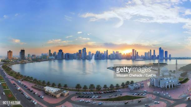 Panoramic View Of City Skyline Against Cloudy Sky