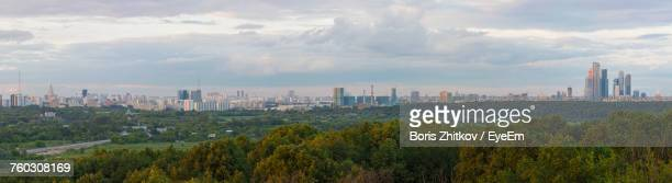 panoramic view of cityscape against cloudy sky - moscow skyline stock pictures, royalty-free photos & images