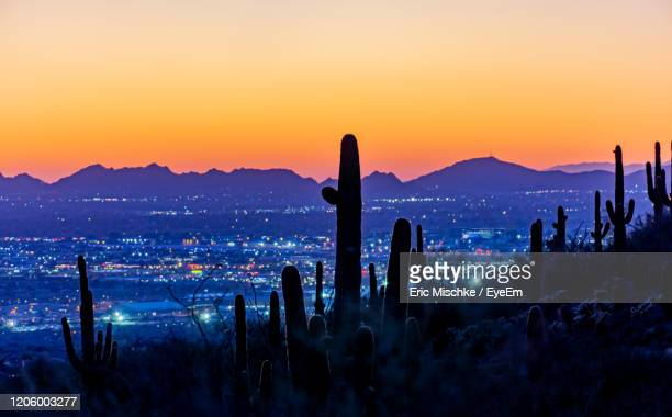 panoramic view of cityscape against sky during sunset - scottsdale arizona stock pictures, royalty-free photos & images