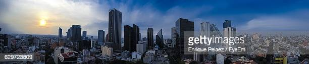panoramic view of cityscape against sky during sunset - メキシコシティ ストックフォトと画像