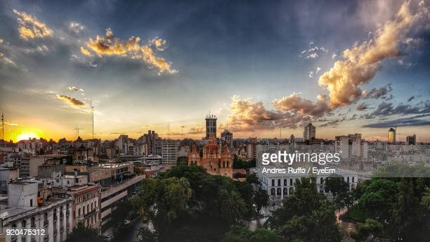 panoramic view of cityscape against sky during sunset - andres ruffo stock photos and pictures