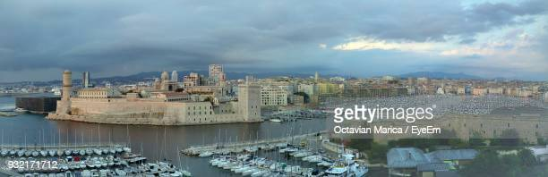 panoramic view of cityscape against sky - marica octavian stock photos and pictures