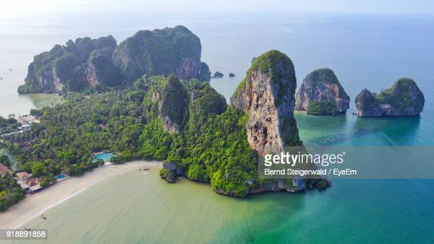 panoramic view of cliff by sea against sky - phuket province stock pictures, royalty-free photos & images
