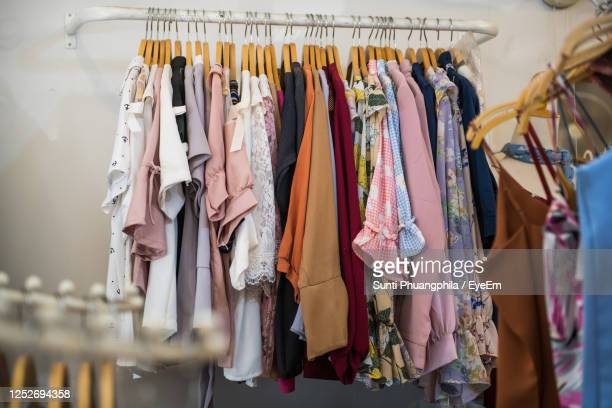 panoramic view of clothes hanging at store - womenswear stock pictures, royalty-free photos & images