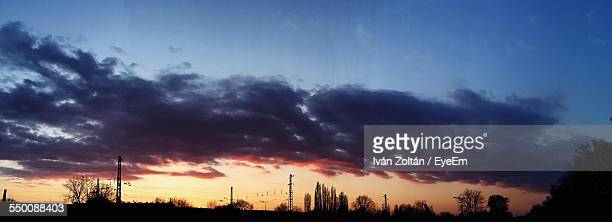 panoramic view of cloudy sky at sunset - iván zoltán stock pictures, royalty-free photos & images