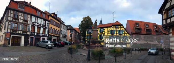 """panoramic view of colorful and medieval facades of the """"place de la sinne"""" (sinne village square) in the village of ribeauvillé, in alsace, france - haut rhin stock pictures, royalty-free photos & images"""