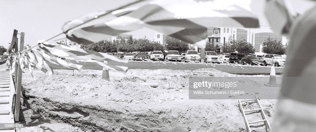 Panoramic View Of Cordon Tape Hanging By Construction Site : Foto stock