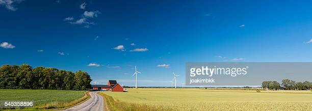 panoramic view of countryside of sweden with wind turbines - landelijke scène stockfoto's en -beelden