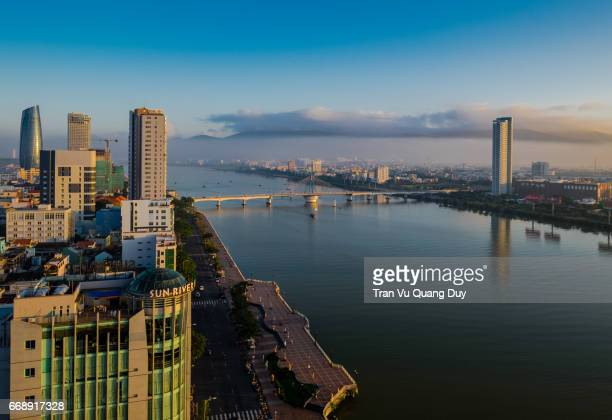 Panoramic view of Danang from above, with dragon bridge and administrative center building.